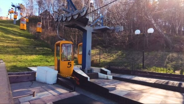 A Small Cable Car on the Hillside with a Blank Yellow Booths in Svetlogorsk, Russia