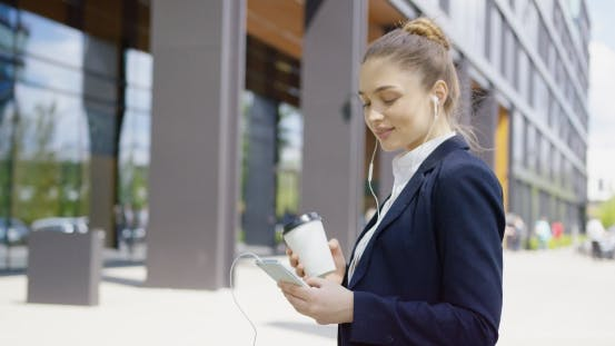 Cover Image for Content Girl Using Phone and Drinking Coffee