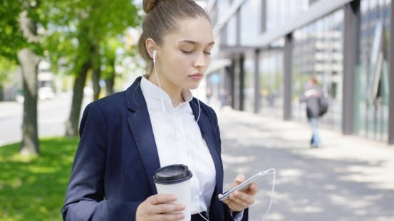 Girl in Suit with Coffee and Smartphone
