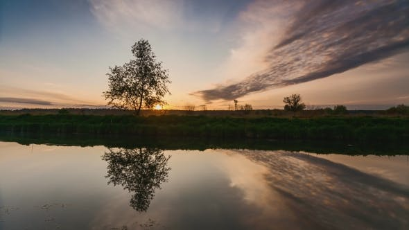 Thumbnail for River in Spring at Dawn. Reflection of Clouds in Water
