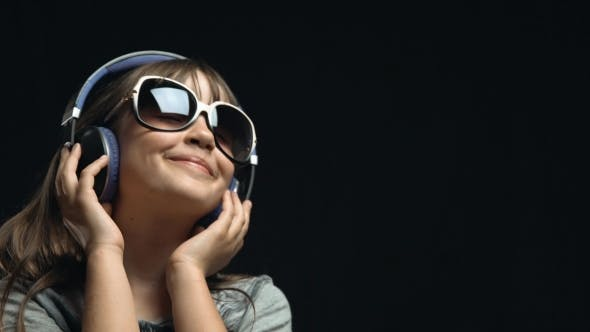 Thumbnail for Young Cute Girl with Headphones and Sunglasses