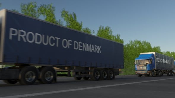 Thumbnail for Moving Freight Semi Trucks with PRODUCT OF DENMARK Caption on the Trailer