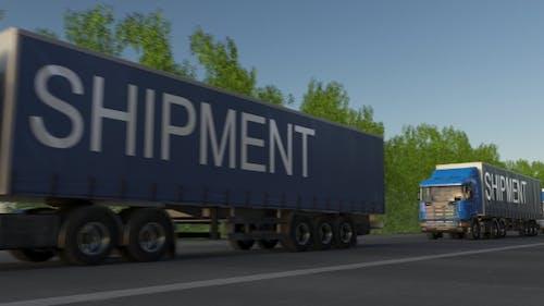 Speeding Freight Semi Trucks with SHIPMENT Caption on the Trailer