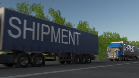 Thumbnail for Speeding Freight Semi Trucks with SHIPMENT Caption on the Trailer