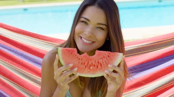 Thumbnail for Cheerful Woman in Bikini Eating Watermelon Slice