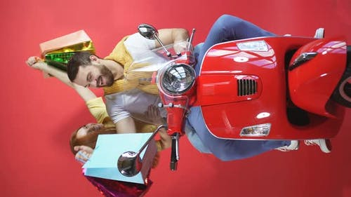 Funny Two Young People Friends Riding a Motorcycle, Scooter Deliver Birthday Gifts, Isolated By Red