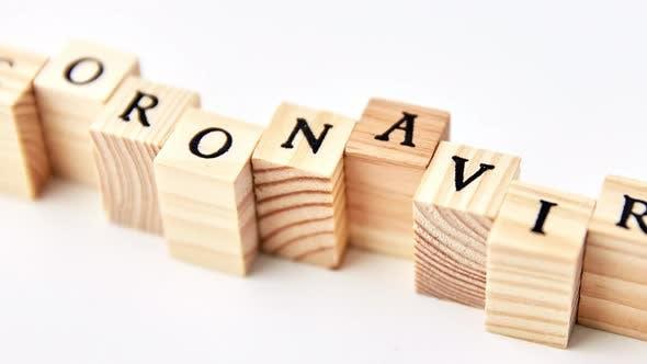 Thumbnail for Coronavirus Word on Wooden Toy Blocks on White