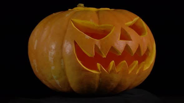 Thumbnail for Jack O' Lantern Pumpkin Rotate on Black Background