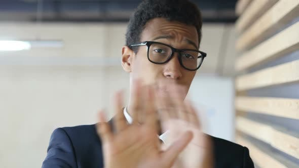 Thumbnail for Black Man in Suit Denying Offer, Gesture of Rejection