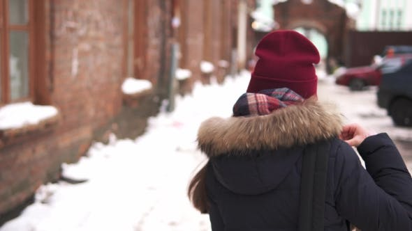 Thumbnail for Young Girl in a Warm Hat and Scarf Walking Forward