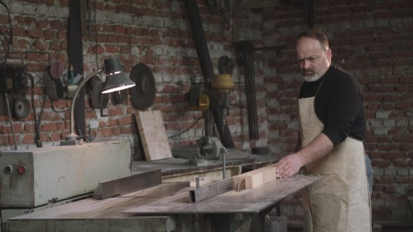 Thumbnail for Carpenter Cutting Wood