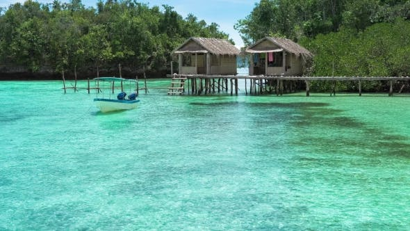 Beautiful Blue Lagoone with Some Bamboo Huts, Kordiris Homestay, Palmtree in Front, Gam Island, West