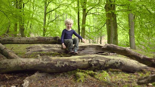 Thumbnail for Small Blonde Boy Playing In Forest