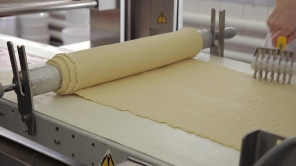 Thumbnail for Roll with Pastry Unwind on Conveyor in Bakery Factory.