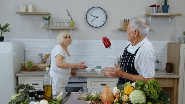 Thumbnail for Senior Vegan Grandmother and Grandfather Cooking Salad with Fresh Vegetables in Kitchen at Home