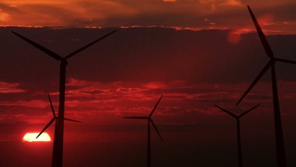 Cover Image for Set of Wind Generators Against Dawn