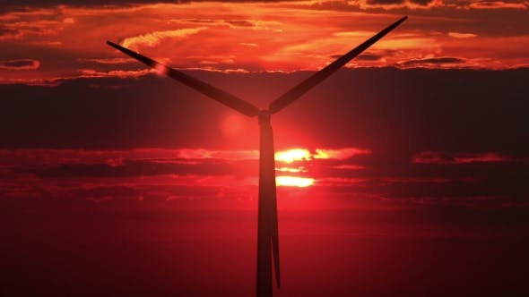 Cover Image for Single Windmill Against Red Sunset
