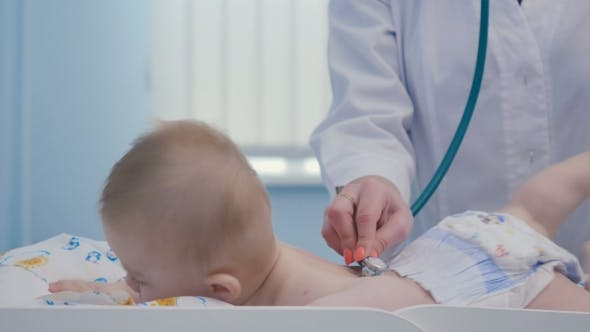 Thumbnail for Doctor's Hands Exam the Body of Little Kid with Stethoscope
