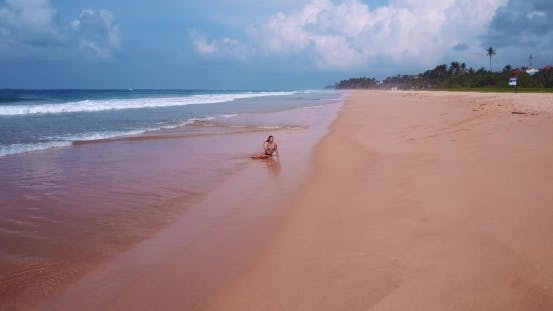 Thumbnail for A Woman on the Beach, Circular Flight From Drone