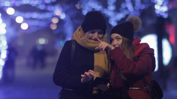 Cover Image for Two Girls Friends Using Mobile Phone at Xmas Night