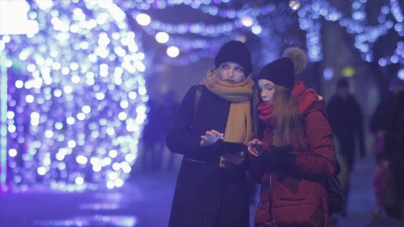 Thumbnail for Two Female Friends Using Mobile Phone at Xmas Night