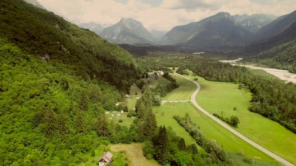 Aerial view of a valley and the main street surrounded by hills in Slovenia.