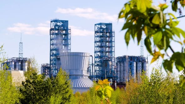 Thumbnail for Oil Refinery with Green Leaves in the Foreground