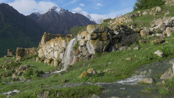 Waterfall on Ancient Wall of Destroyed Village