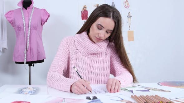 Thumbnail for Designer Draws Sketches for a Fashion Magazine of Women's Clothing