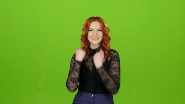 Thumbnail for Redhaired Girl Begins To Dance, She Is in a Good Mood. Green Screen