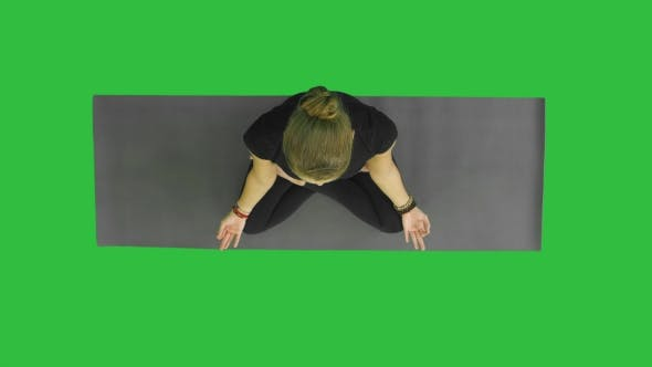 Thumbnail for Attractive Young Woman Working Out, Doing Yoga Exercise, Sitting in Half Lotus, Ardha Padmasana with