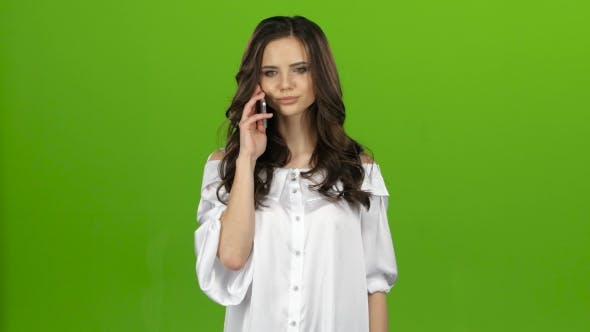Thumbnail for Brunette Picks Up the Phone, Dials the Number She Wants and Rings. Green Screen