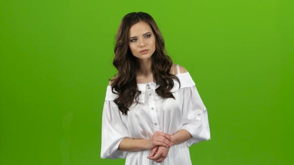 Thumbnail for Girl Tries To Find a Guy in the Crowd, Then Waves To Him. Green Screen