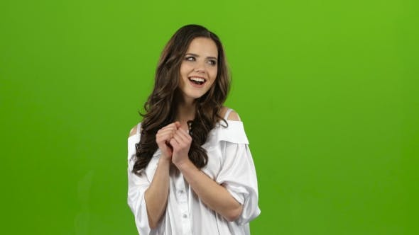 Thumbnail for Girl Experiences Happiness, Shows Her Thumbs Up, Smiles Sweetly. Green Screen