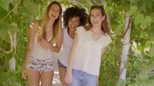 Happy Women Walking in Hedge