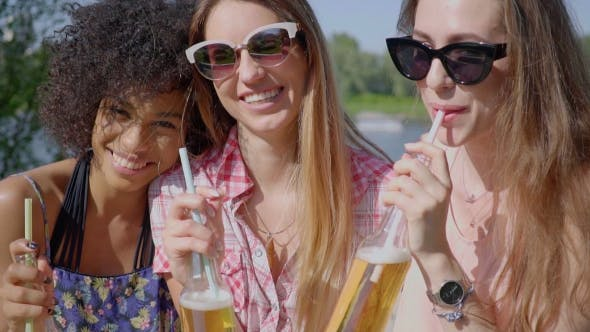 Thumbnail for Cheerful Young Girls Having Beer