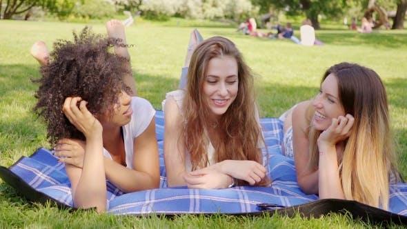Happy Women Lying on Meadow