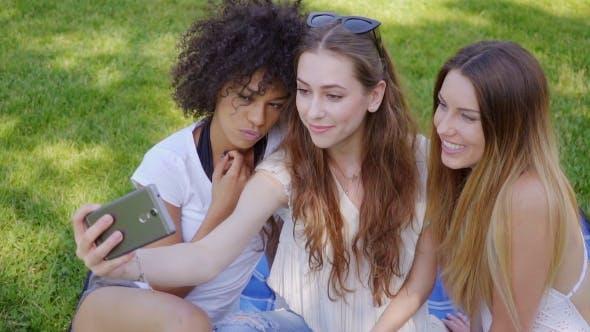 Thumbnail for Pretty Girls Taking Selfie on Lawn