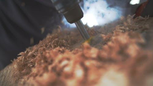 Carpenter Drilling in Wood