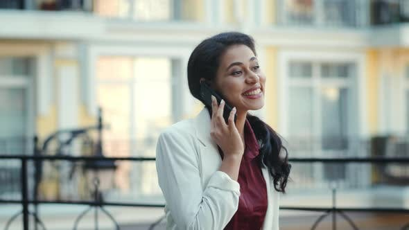 Businesswoman Calling Phone Outside