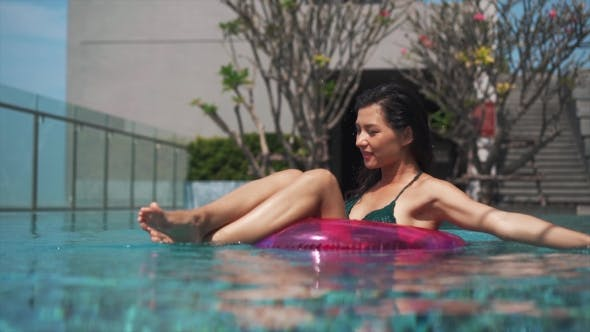 Thumbnail for Pretty Girl Floating in Ring Buoy in Swimming Pool
