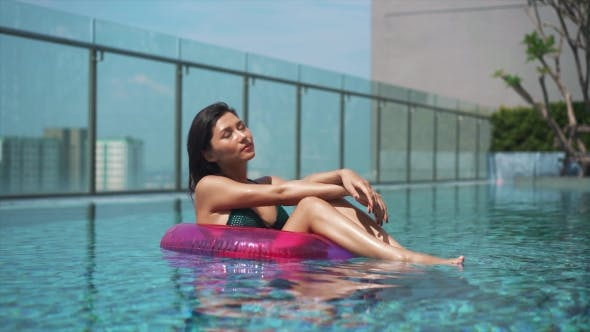 Thumbnail for Pretty Girl Resting in Ring Buoy in Swimming Pool