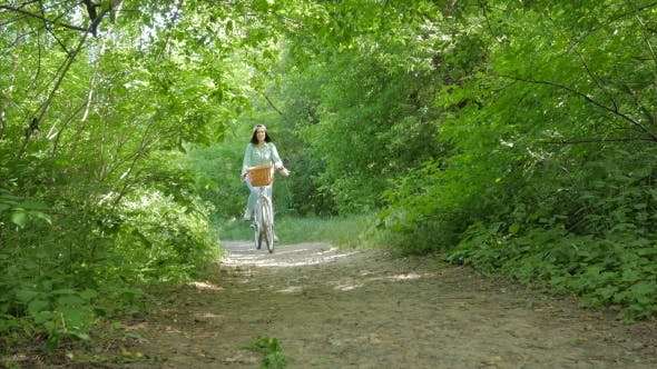 Thumbnail for Young Beautiful Woman Wearing Casual Clothing Jeans, Cap and Backpack Riding a Vintage White Bicycle