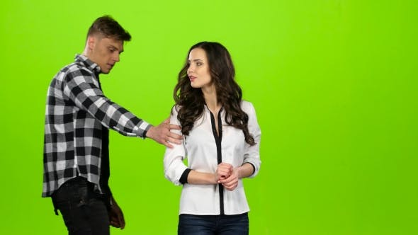 Thumbnail for Girl Is Waiting for Her Beloved Guy, He Comes and Gently Hugs. Green Screen