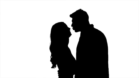Thumbnail for Lovers Talk and Try To Kiss, Flirt and Start Kissing Each Other. Silhouette. White Background