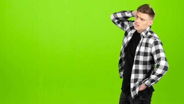 Thumbnail for Guy Is Waiting for His Girlfriend She Comes and Gently Kisses Him. Green Screen