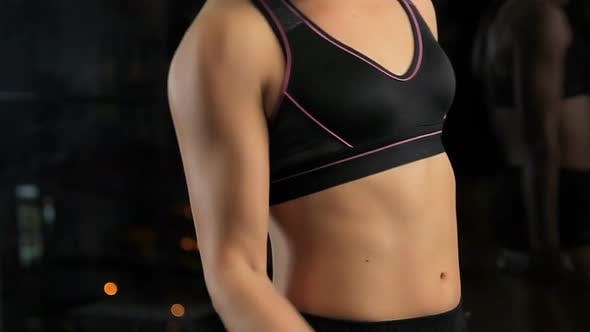 Strong Woman With Ideal Fit Body Doing Dumbbell Exercises