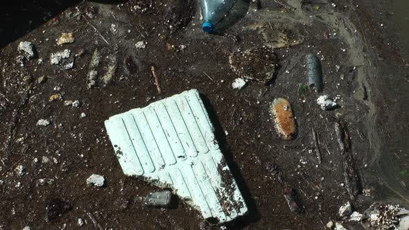 Thumbnail for Water Pollution With Dirt And Plastic Garbage Floating On The Surface Of The Sea