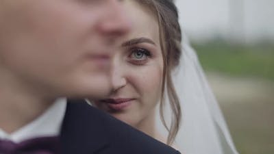 Groom with Bride. Wedding Couple. Bride Looks at Camera. Happy Family