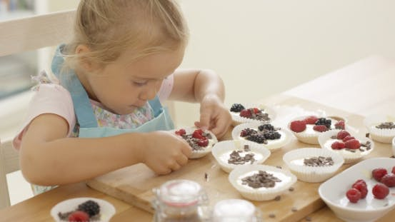 Thumbnail for Muffin Cups Being Prepared By Little Girl